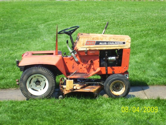 The Pictures Are Alittle Bit Far Away But Wanted To Show The Hole Tractor...  I Will Take Pics As We Dissiemble This Thing ... To Show Pits Cracks Or  What ...